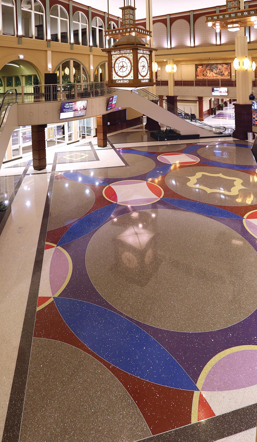 main level of Grand Victoria Casino terrazzo with clock and escalators